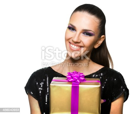 455111881istockphoto Beautiful woman holding a  gift over white background 456040933