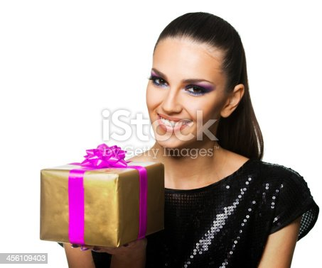 455111881istockphoto Beautiful woman holding a  gift over white background 456109403