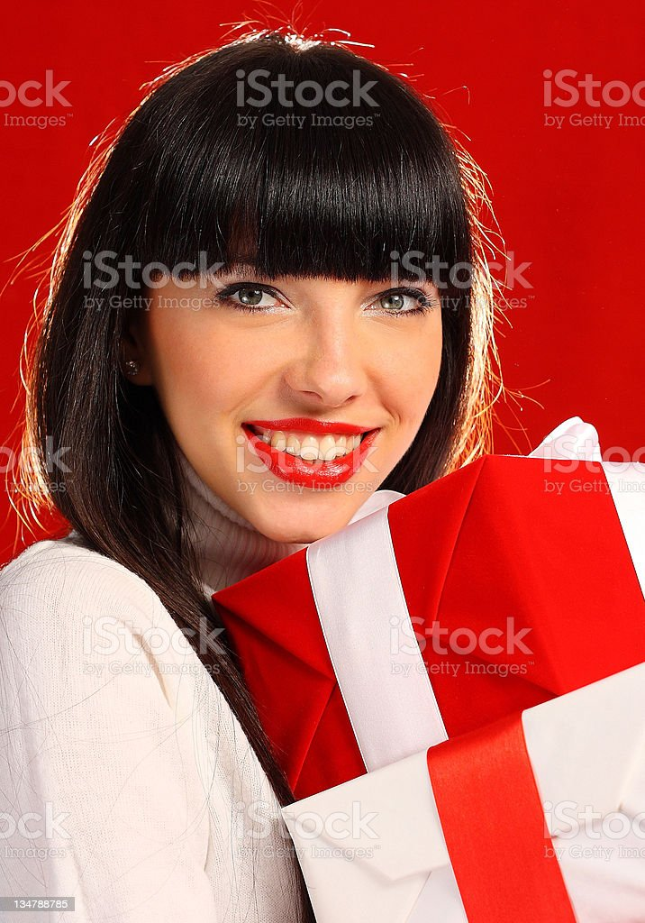 Beautiful woman holding a gift royalty-free stock photo