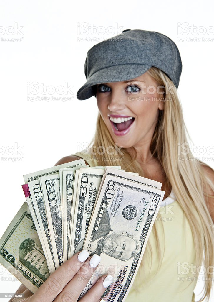 Beautiful woman holding a hand full of cash royalty-free stock photo