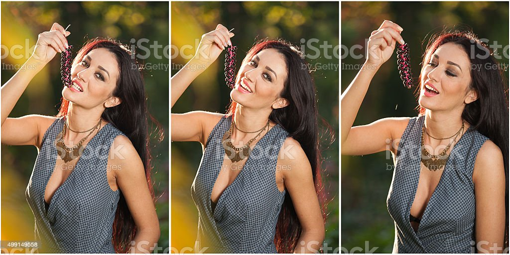 Beautiful woman holding a ripe grapes bunch stock photo