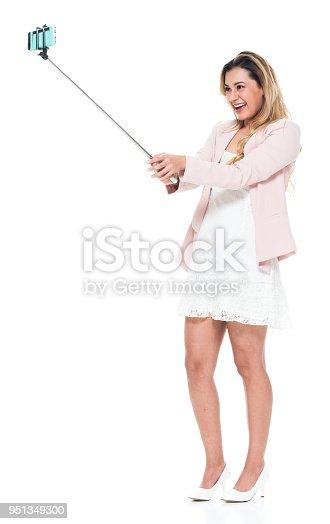 Beautiful woman holding a selfie stick