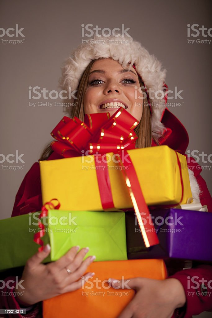 beautiful woman holding a stack of christmas presents royalty-free stock photo