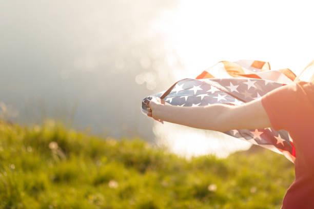 Beautiful woman holding american flag patriotic holiday picture id1148911224?b=1&k=6&m=1148911224&s=612x612&w=0&h=qis5jrnk7c1q  aqrfmhtkp9tcj1jf9vbmk5olmgc74=
