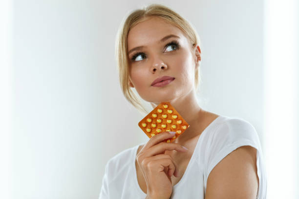 Beautiful Woman Holding Birth Control Pills, Oral Contraceptive Woman With Birth Control Pills. Healthy Beautiful Girl Holding Blister Pack With Oral Contraceptive Pills In Hand And Thinking Should She Take A Pill. Medicine, Health Care Concept. High Resolution contraceptive stock pictures, royalty-free photos & images