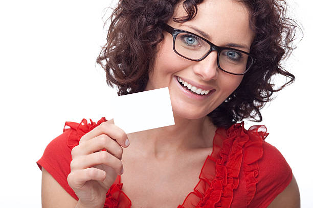 beautiful woman holding blank card - gift voucher or card stock photos and pictures