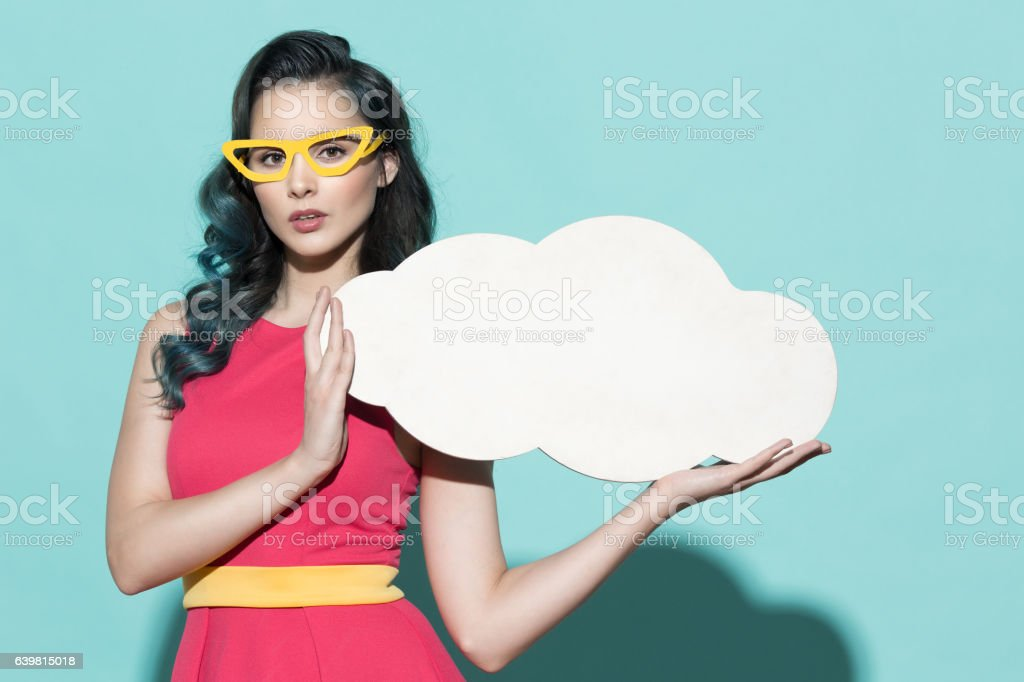 Beautiful woman holding empty blank form as clouds. stock photo