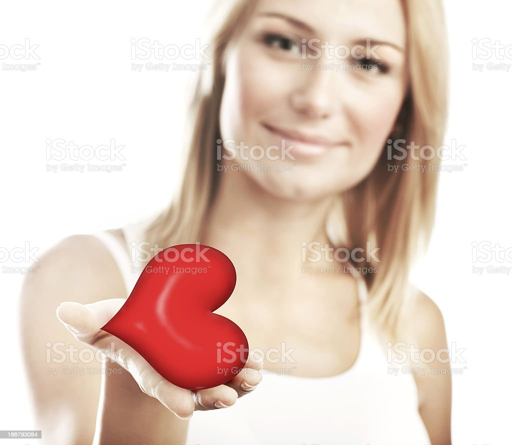 Beautiful woman holding heart, selective focus royalty-free stock photo