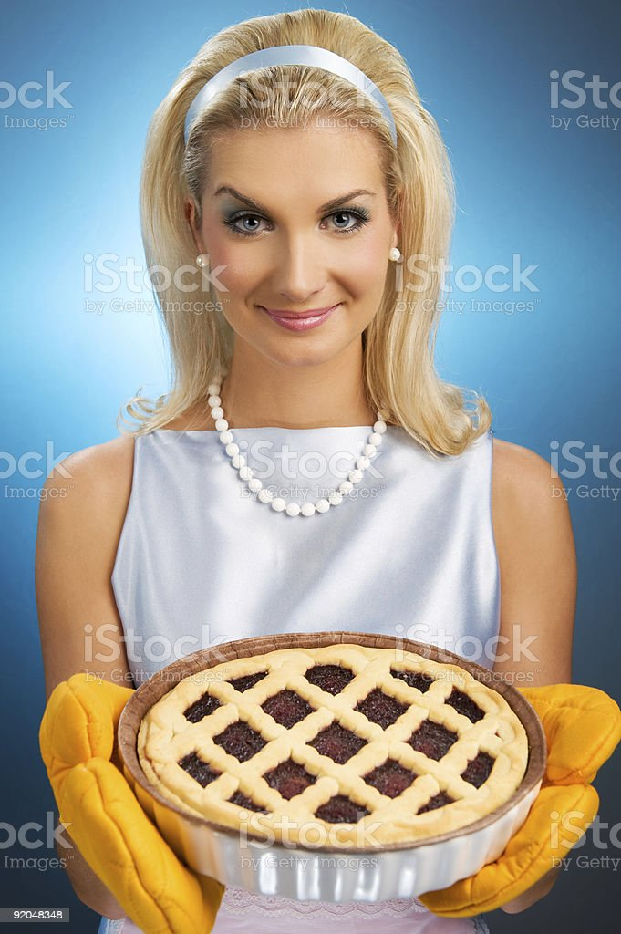 Beautiful woman holding hot italian pie. stock photo