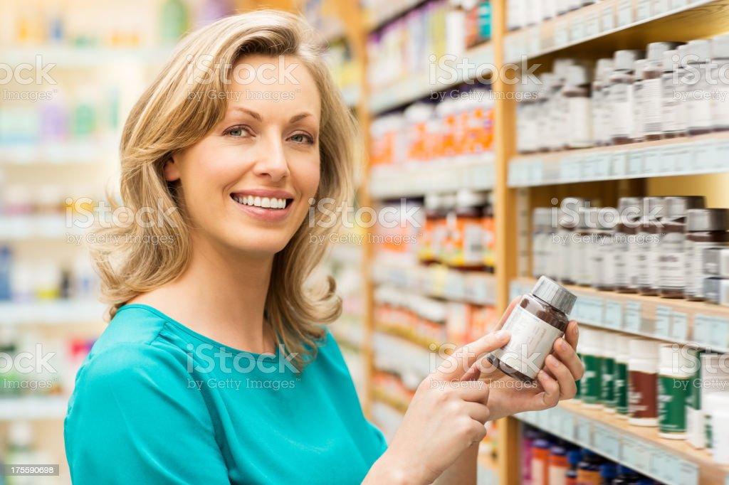 Beautiful Woman Holding Pill Bottle stock photo