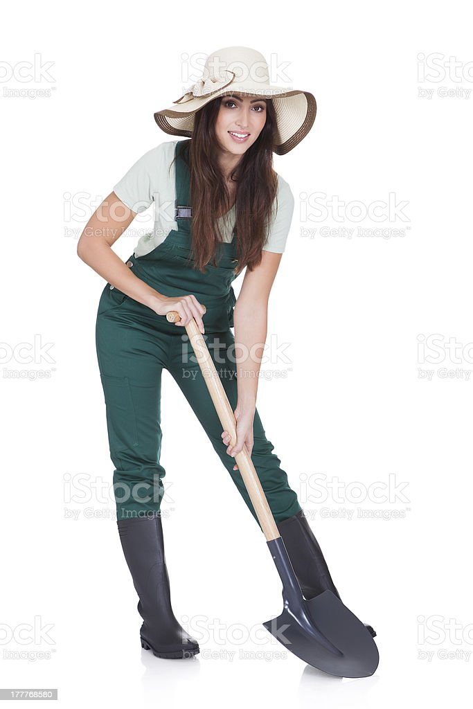 Beautiful Woman Holding Plant And Gardening Shovel royalty-free stock photo