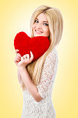 istock Beautiful woman holding red heart 533779245