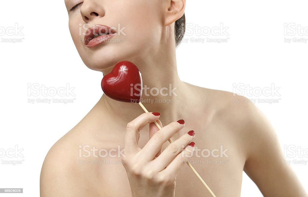 Beautiful woman holding red heart. royalty-free stock photo