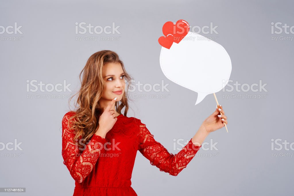 Beautiful woman holding speech bubble with copy space stock photo