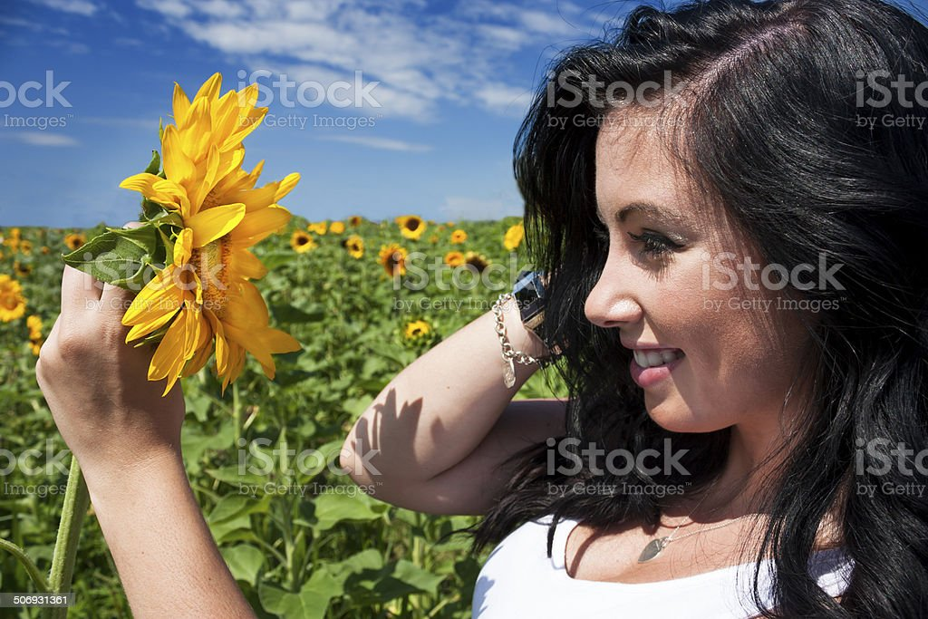 Beautiful woman holding sunflower stock photo