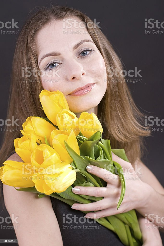 Beautiful woman holding  tulips royalty-free stock photo