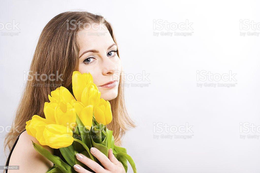 Beautiful woman holding  tulips royalty-free stock photo