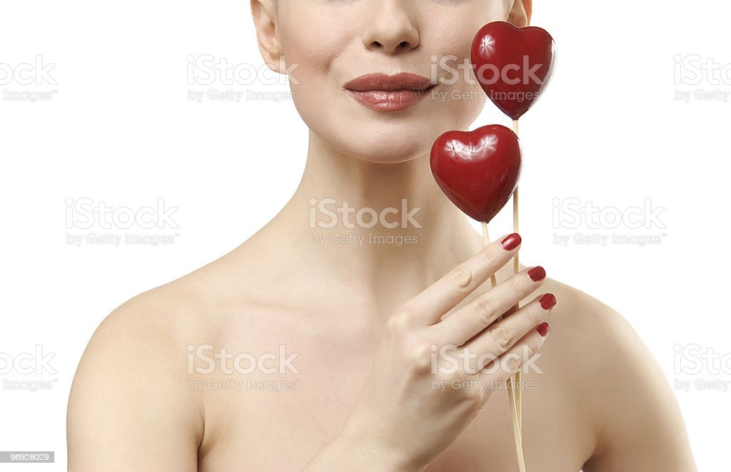 Beautiful woman holding two red hearts. royalty-free stock photo