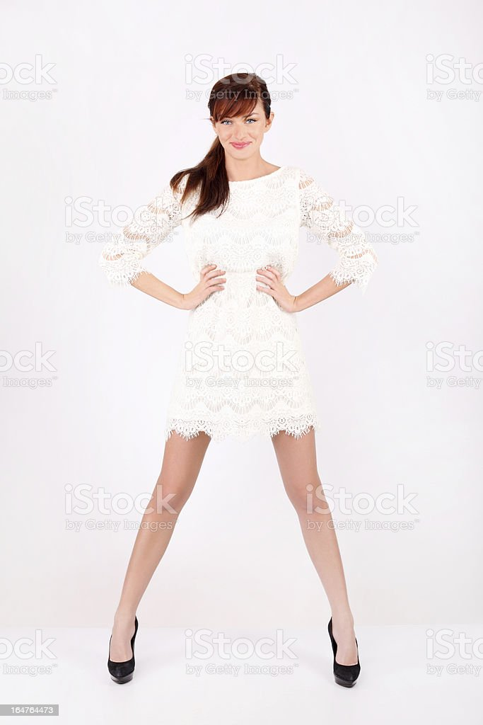 Beautiful woman holds by waist, legs wide apart. royalty-free stock photo