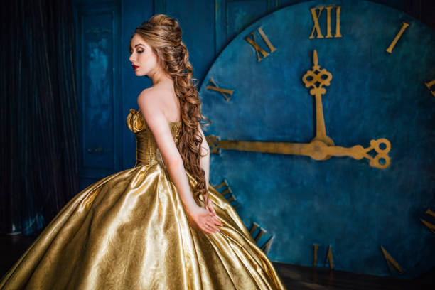 Beautiful woman in a ball gown - Photo