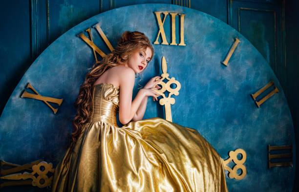 beautiful woman in a ball gown - abendkleid lang blau stock-fotos und bilder