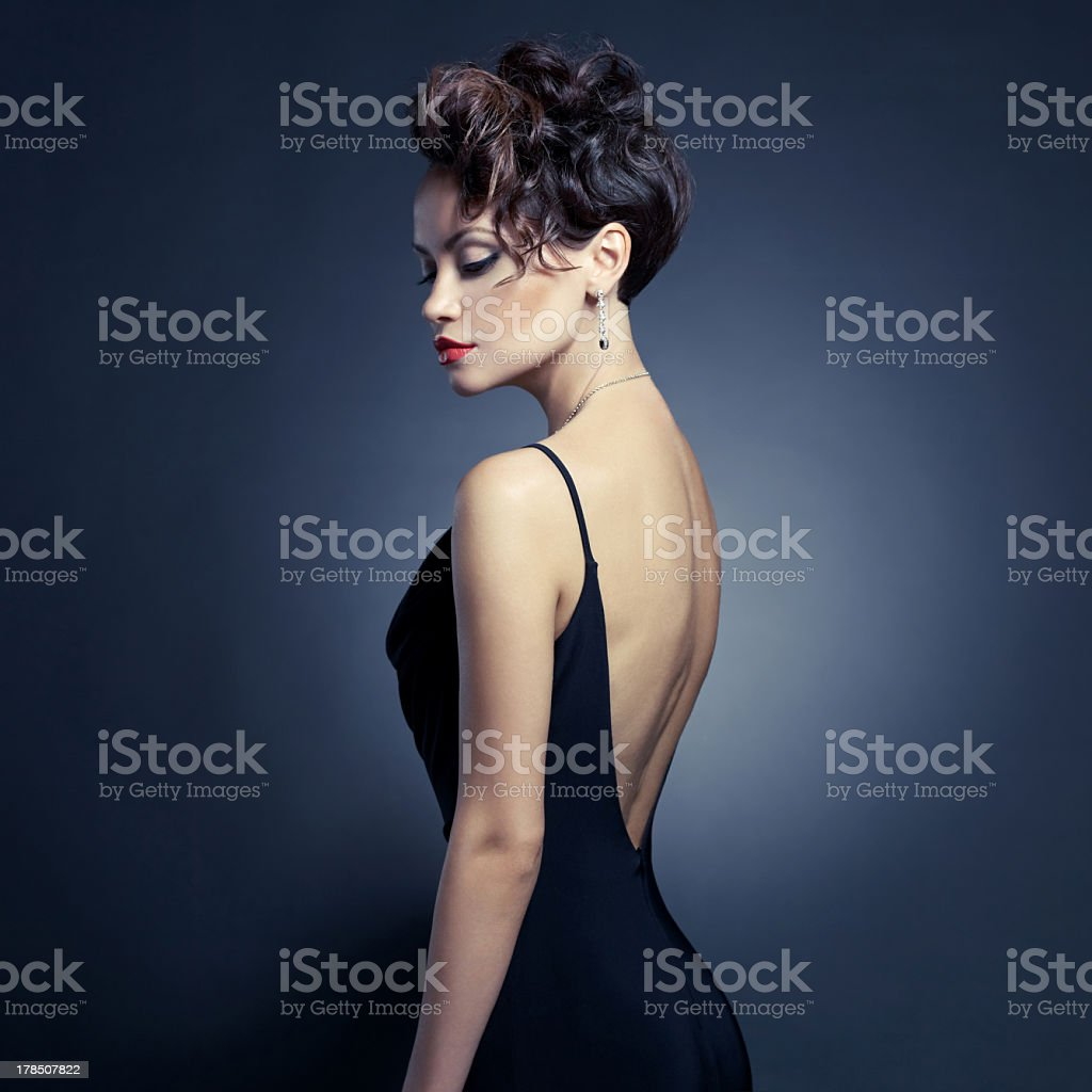 A beautiful woman in a evening dress stock photo