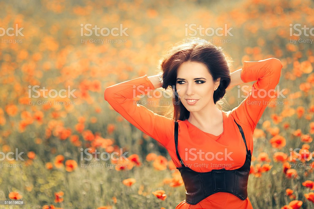 Beautiful Woman in a Field of Poppies stock photo