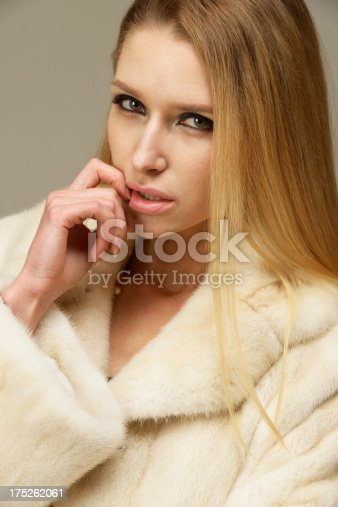 Beautiful woman in a fur coat. Technical Details: Nikon D800. ISO 100.