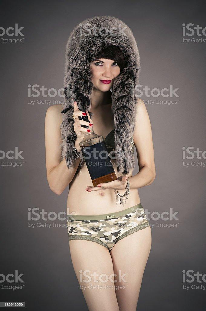 beautiful woman in a fur hat stock photo