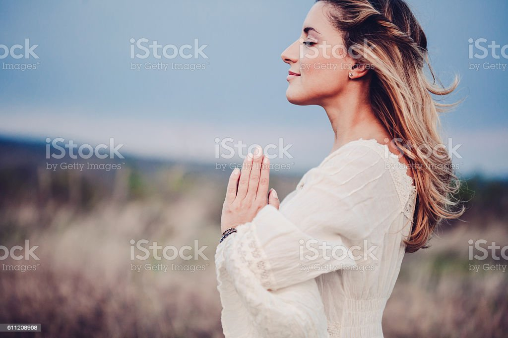 Beautiful woman in a meadow stock photo