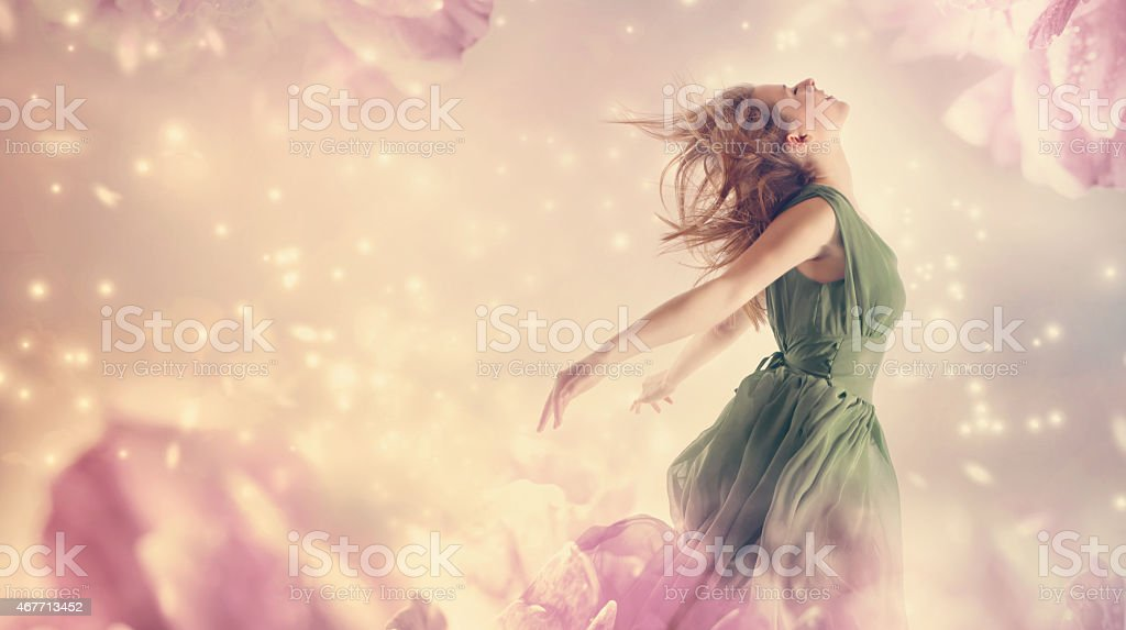 Beautiful woman in a pink peony flower stock photo