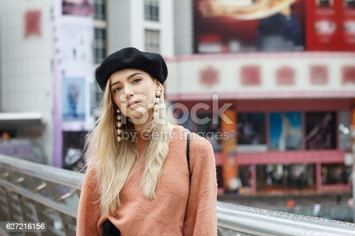 istock Beautiful woman in a pink sweater 627216156