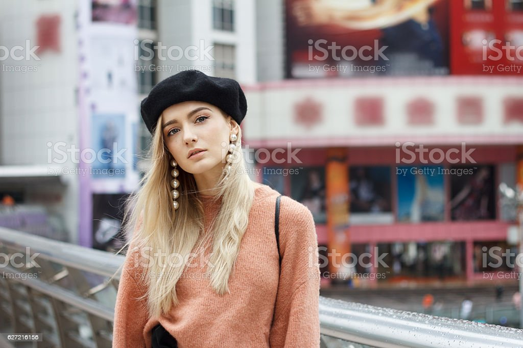 Beautiful woman in a pink sweater stock photo