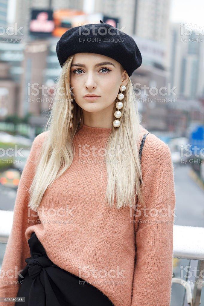 Beautiful woman in a pink sweater stock photo