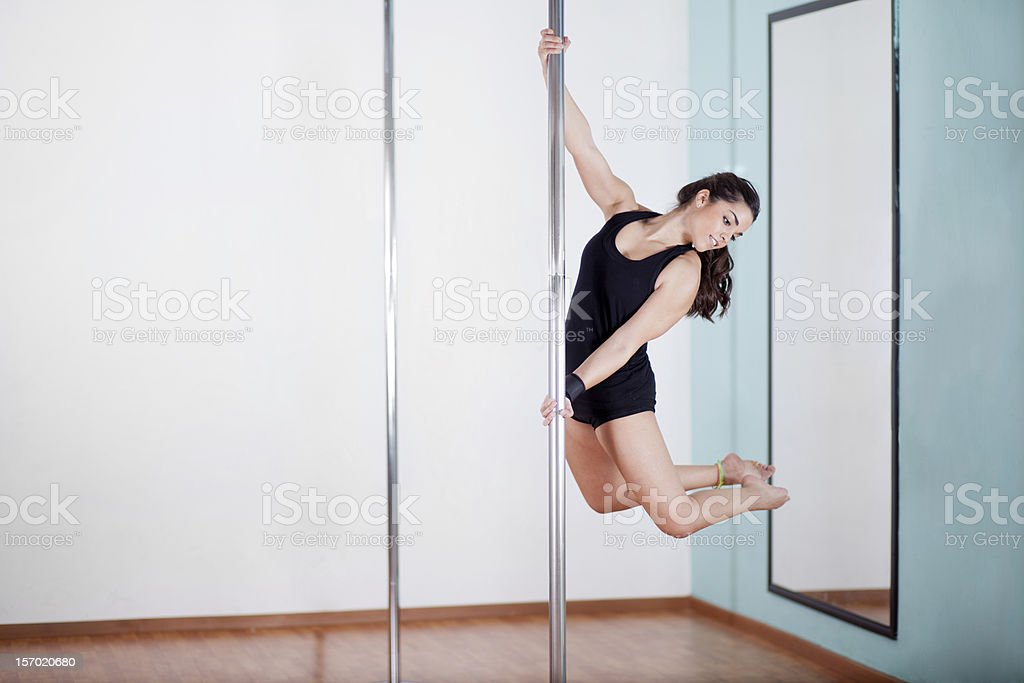 Beautiful woman in a pole dancing practice stock photo