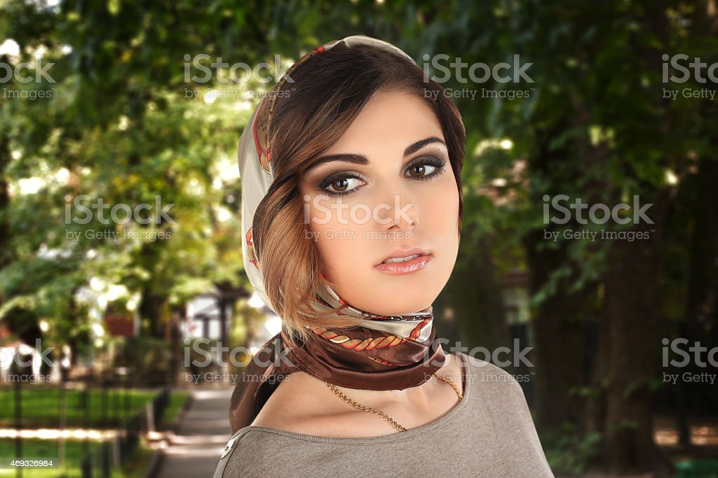 beautiful woman in a scarf on her head stok fotoğrafı