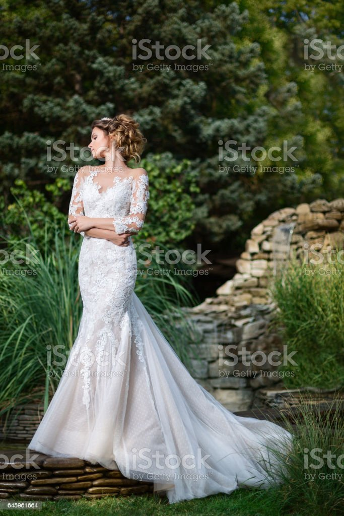 beautiful woman in a white dress stock photo