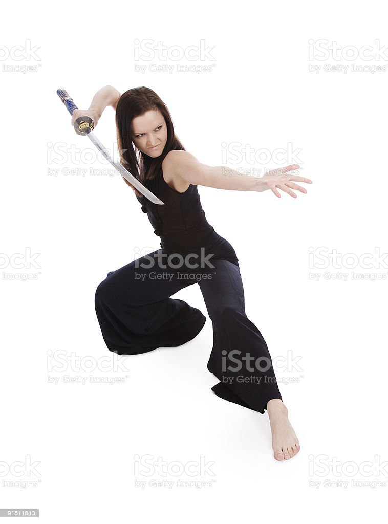 Beautiful woman in an aggressive posture with a sword royalty-free stock photo