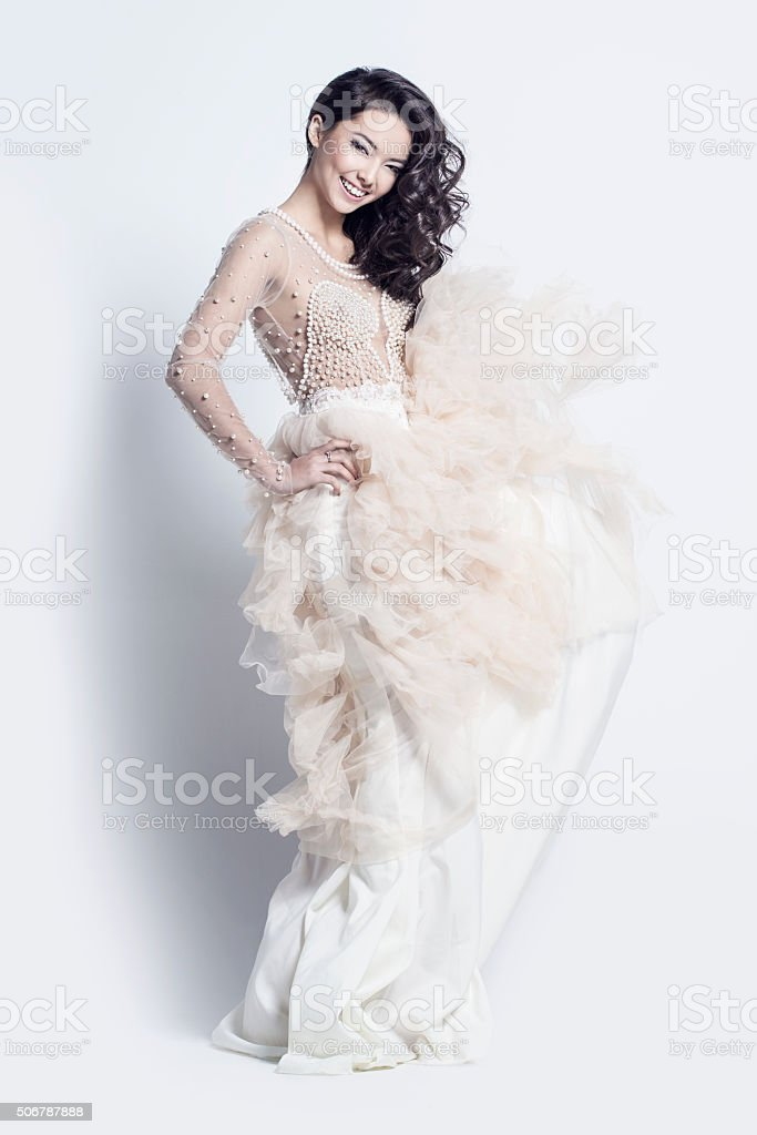 Beautiful woman in an incredible dress stock photo