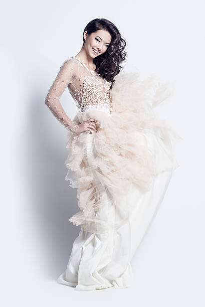 beautiful woman in an incredible dress - prom fashion stock photos and pictures
