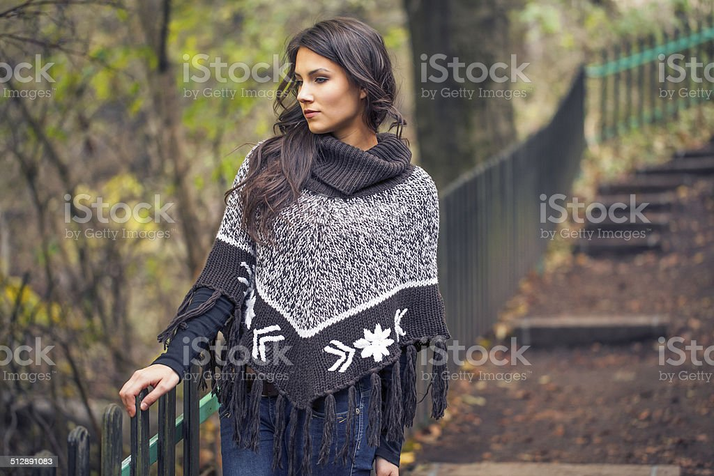 Beautiful woman in autumn forest stock photo
