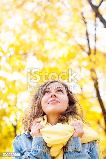 istock Beautiful woman in autumnal park 505952569