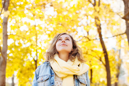 istock Beautiful woman in autumnal park 507955817