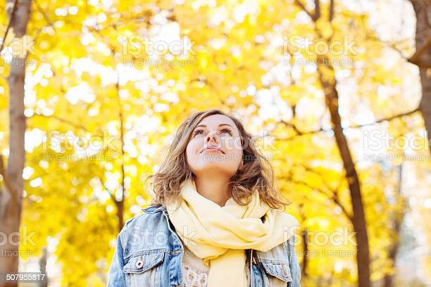 Beautiful Woman In Autumnal Park Stock Photo - Download Image Now