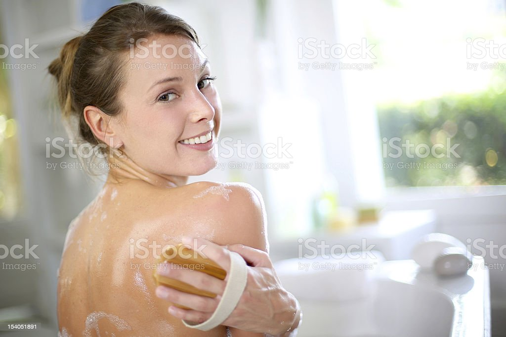 Beautiful woman in bathtub stock photo