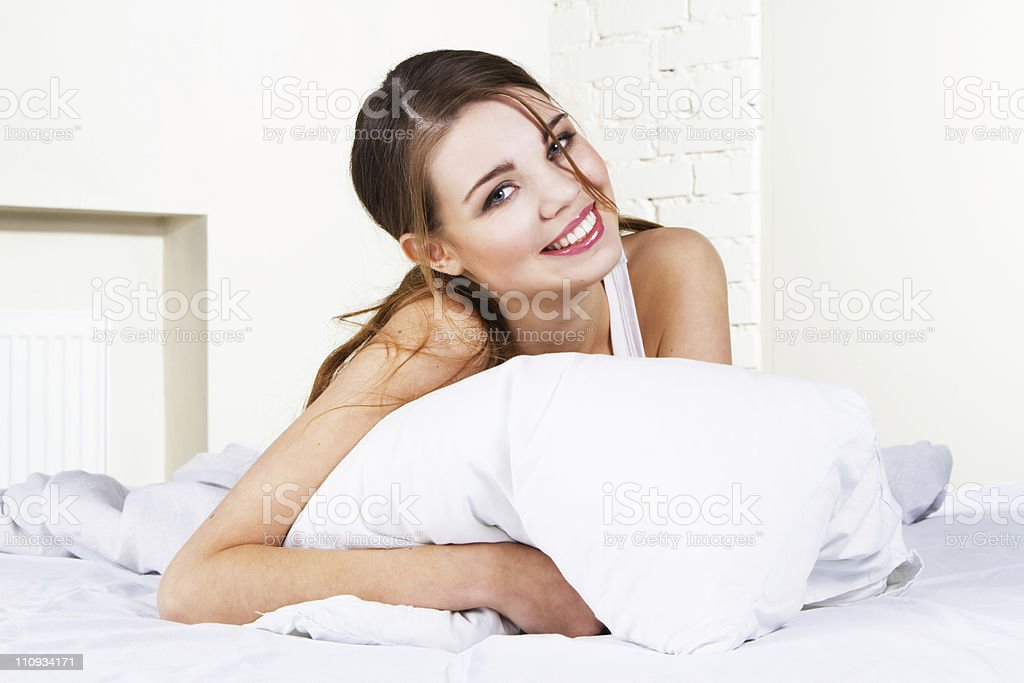 Beautiful woman in bed royalty-free stock photo