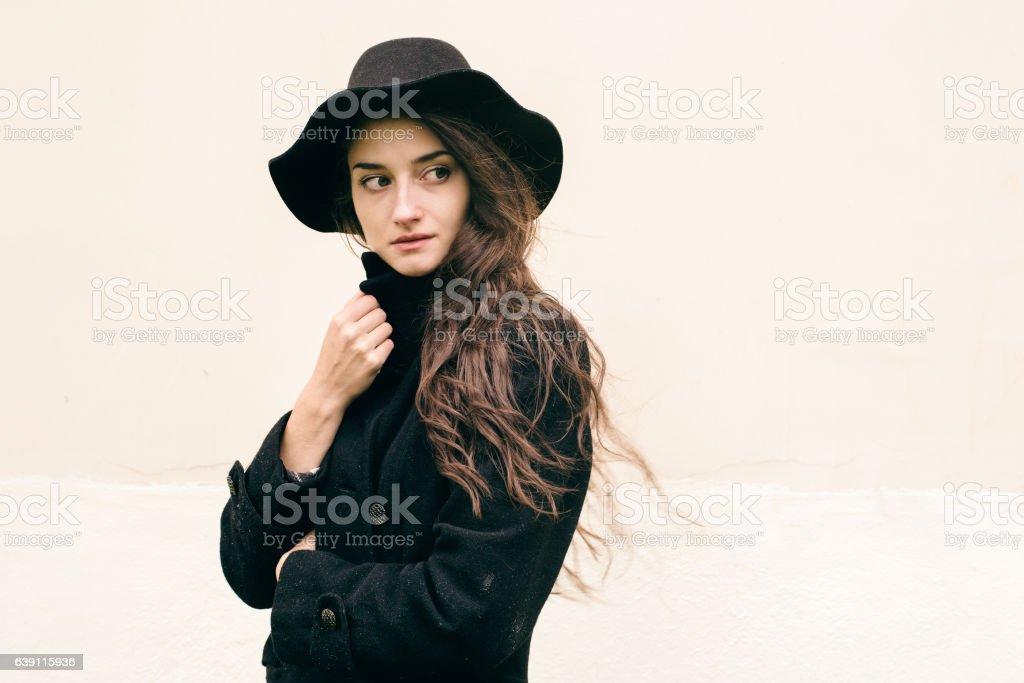 Beautiful woman in black coat street portrait fashion. - Photo