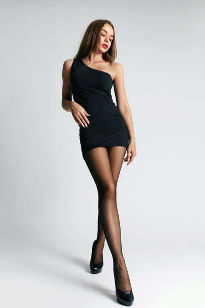 dd8d07592a2 Beautiful Woman In Black Dress And Stockings stock photo