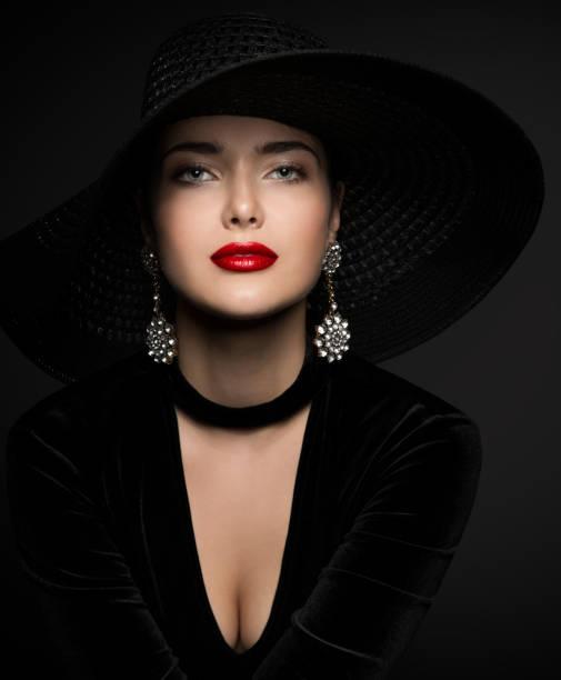 Beautiful Woman in Black, Elegant Lady Red Lips and Earrings Jewelry, Beauty Portrait stock photo