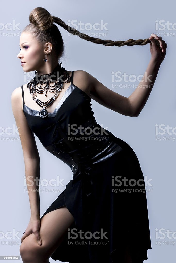 beautiful woman in black evening gown royalty-free stock photo